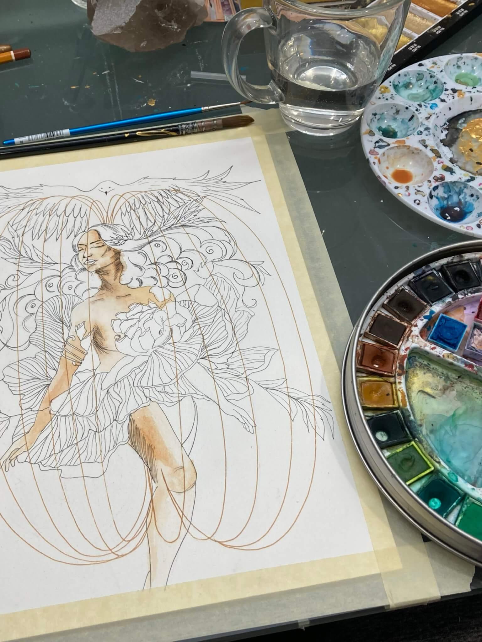 Oeuvre aquarelle en processus de création sur espace de travail
